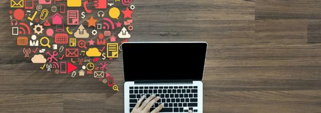 Vários ícones relacionados a marketing digital saindo de um laptop